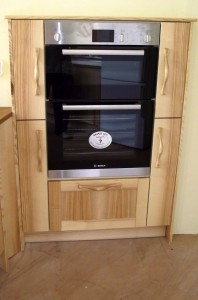 olive ash kitchen cupboards around oven