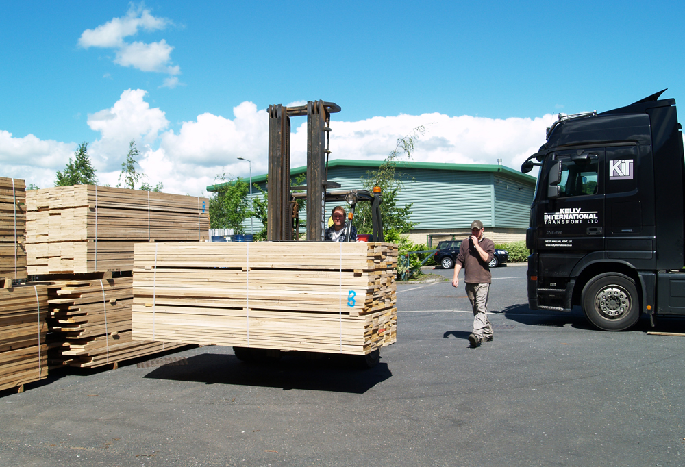 Tony on forklift unloading timber