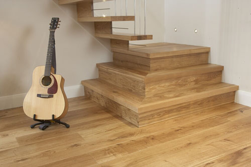 Oak flooring guide to surface treatments british for Wood floor knot filler