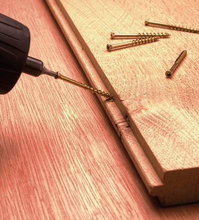 An image of mechanical fixing of hardwood flooring using tongue tite flooring screws