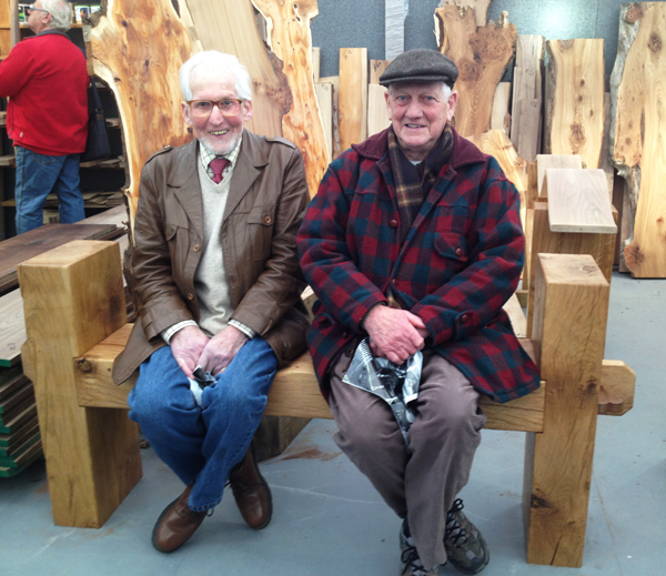 Customers enjoying a brief rest on our lovely wavy oak benches