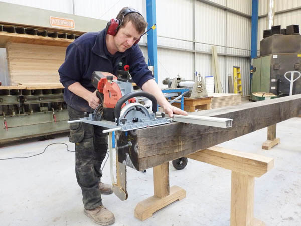 Jason cutting a sawn air dried oak beam to length