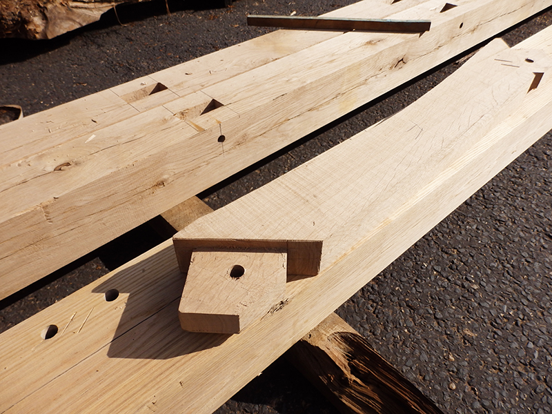 The beams have been machined with traditional draw pegged mortise and tenon joints