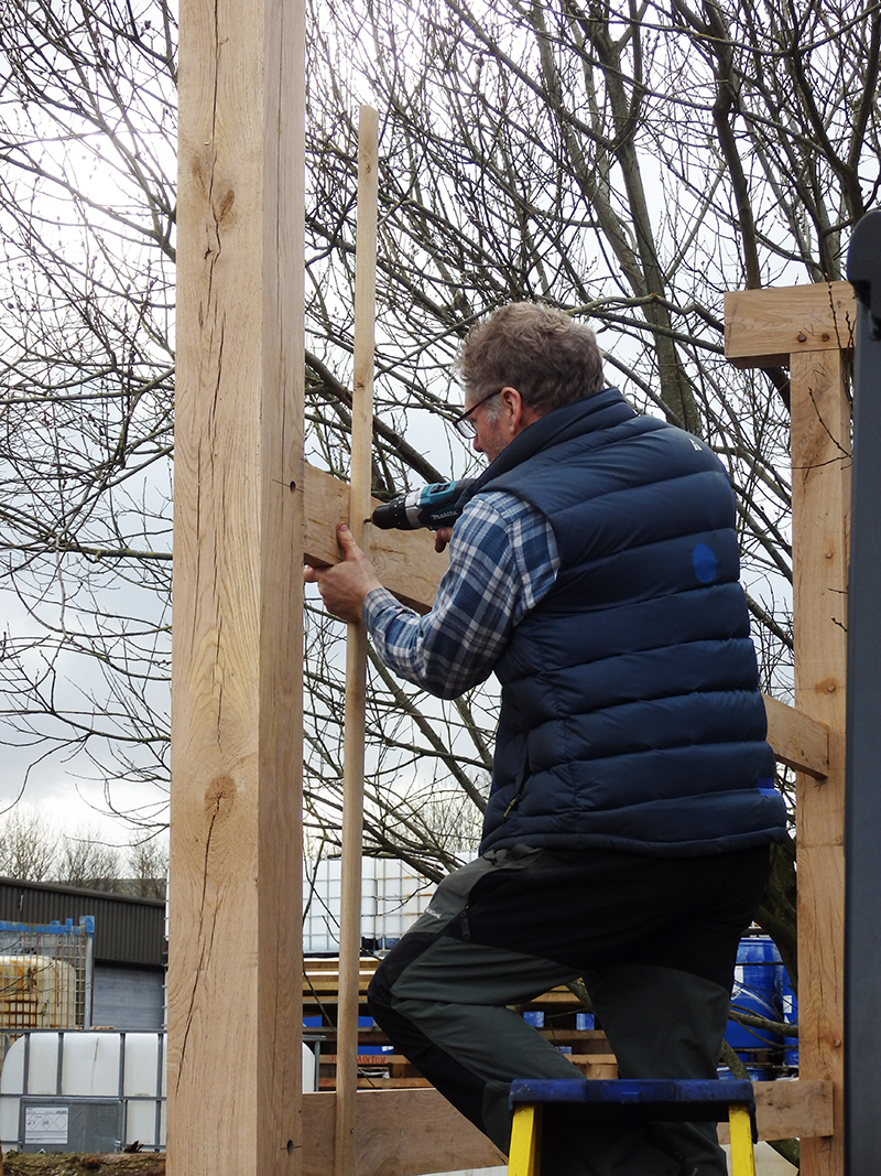 Tony carefully tamps the joints into place