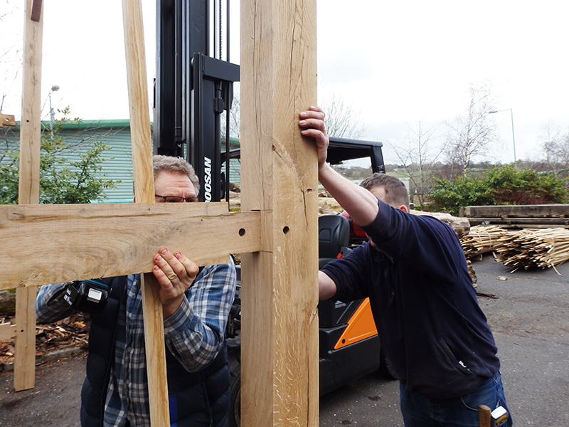 It's a two man job to control a hardwood framework of this size - Tony and Jason have it all under control